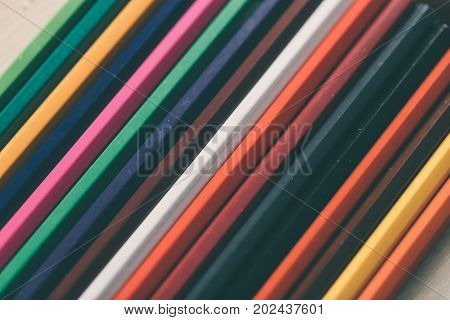 Many colored pencils for drawing. Object photo.