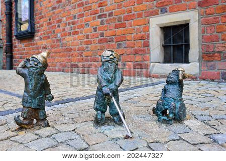 WROCLAW POLAND - JUNE 2017: Wroclaw a miniature statue of a gnome on the main square of the city.