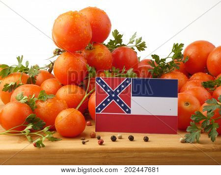 Mississippi Flag On A Wooden Panel With Tomatoes Isolated On A White Background