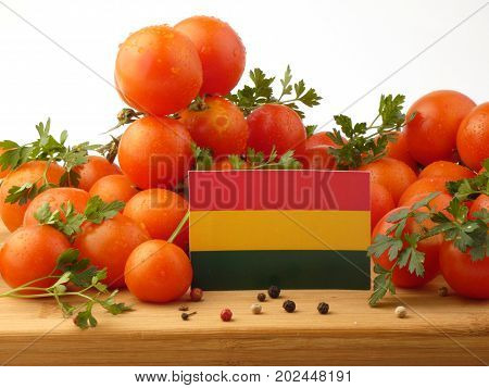 Bolivian Flag On A Wooden Panel With Tomatoes Isolated On A White Background