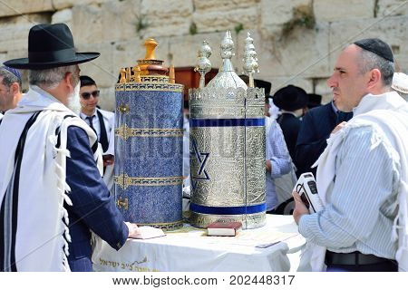 JERUSALEM ISRAEL - APRIL 2017: Jewish man celebrate Simchat Torah. Simchat Torah is a celebratory Jewish holiday marks the completion of the annual Torah reading cycle