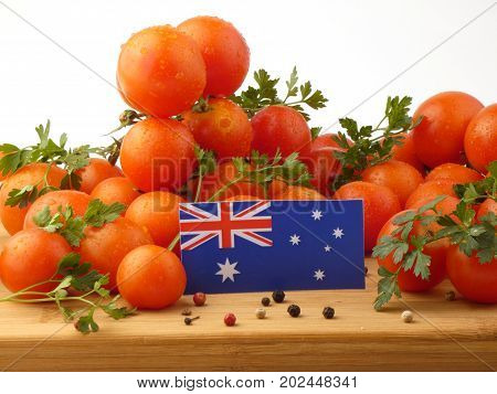 Australian Flag On A Wooden Panel With Tomatoes Isolated On A White Background