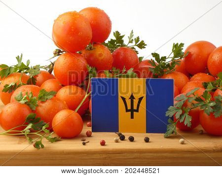 Barbados Flag On A Wooden Panel With Tomatoes Isolated On A White Background