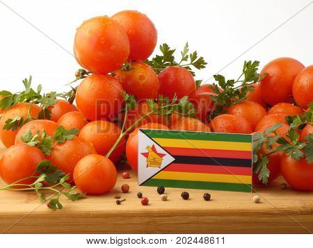 Zimbabwe Flag On A Wooden Panel With Tomatoes Isolated On A White Background