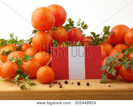 Peruvian Flag On A Wooden Panel With Tomatoes Isolated On A White Background