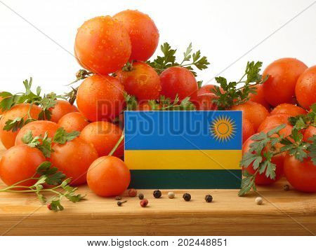 Rwanda Flag On A Wooden Panel With Tomatoes Isolated On A White Background