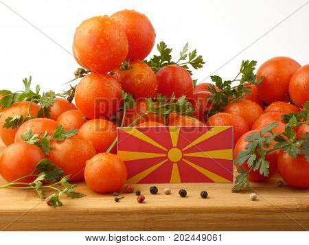 Macedonian Flag On A Wooden Panel With Tomatoes Isolated On A White Background