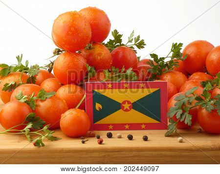 Grenada Flag On A Wooden Panel With Tomatoes Isolated On A White Background