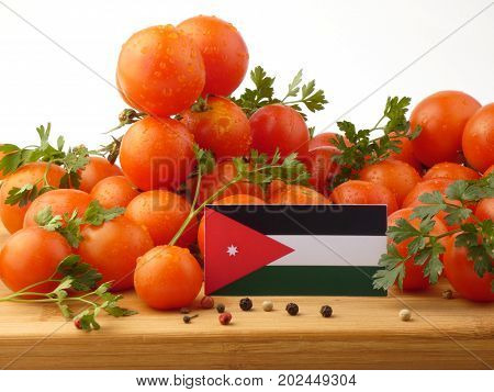 Jordanian Flag On A Wooden Panel With Tomatoes Isolated On A White Background