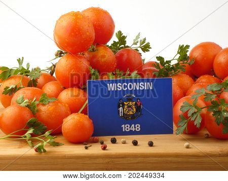 Wisconsin Flag On A Wooden Panel With Tomatoes Isolated On A White Background