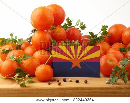 Arizona Flag On A Wooden Panel With Tomatoes Isolated On A White Background