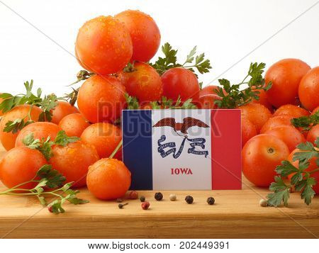 Iowa Flag On A Wooden Panel With Tomatoes Isolated On A White Background