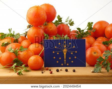 Indiana Flag On A Wooden Panel With Tomatoes Isolated On A White Background