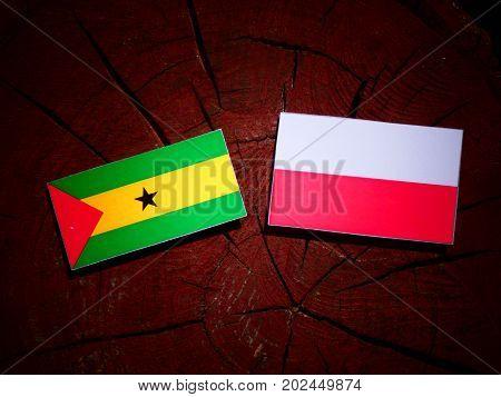 Sao Tome And Principe Flag With Polish Flag On A Tree Stump Isolated