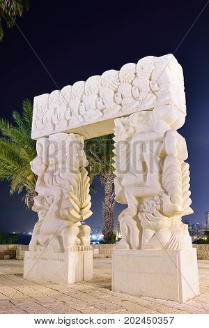 TEL AVIV ISRAEL- APRIL 2017: Faith stone sculpture on the highest point of Old Yafo on the St. Peter Church background Tel-Aviv. Israel