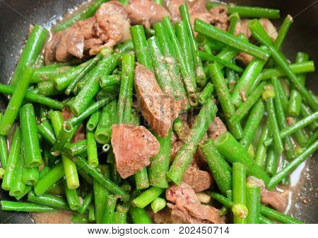 Chinese Cuisine and Food Stir Fried Flowering Chinese Garlic Chives or Ku Chai with Chicken Livers.