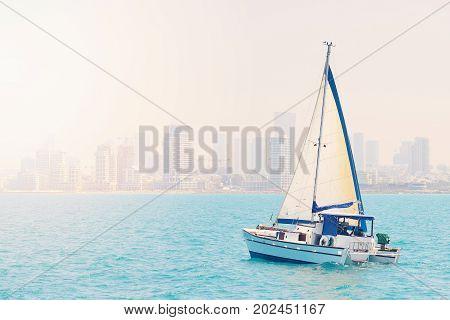TEL AVIV ISRAEL - APRIL 2017: luxury yacht in the open sea against the backdrop of Tel Aviv.
