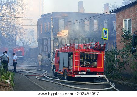 ROSTOV-ON-DON RUSSIA - AUGUST 21 2017: fire trucks and rescue workers at the burned-out house. The largest fire in the history of the city. Rostov-on-don Russia.