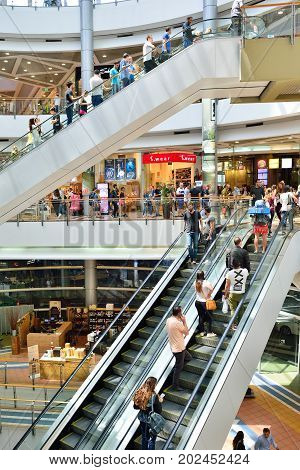 TEL AVIV ISRAEL- APRIL 2017: People visits shopping centre in Azrieli Center complex of three skyscrapers in Tel Aviv