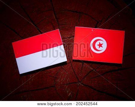 Indonesian Flag With Tunisian Flag On A Tree Stump Isolated