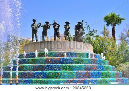 TEL AVIV ISRAEL- APRIL 2017: Statue of five musicians in a fountain near the Azrieli