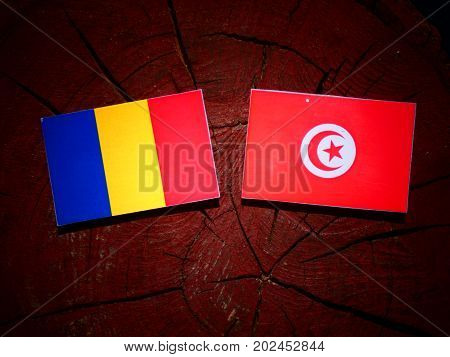 Chad Flag With Tunisian Flag On A Tree Stump Isolated