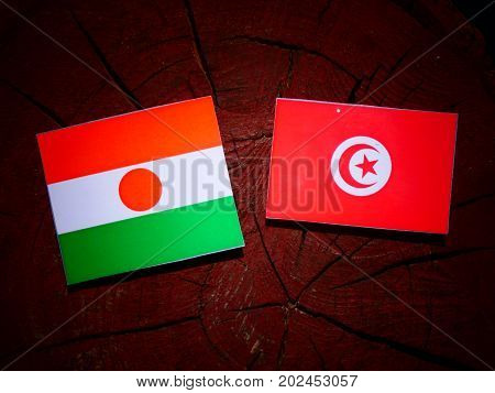 Niger Flag With Tunisian Flag On A Tree Stump Isolated