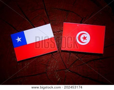 Chilean Flag With Tunisian Flag On A Tree Stump Isolated