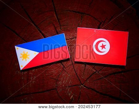 Philippines Flag With Tunisian Flag On A Tree Stump Isolated