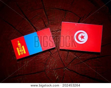 Mongolian Flag With Tunisian Flag On A Tree Stump Isolated