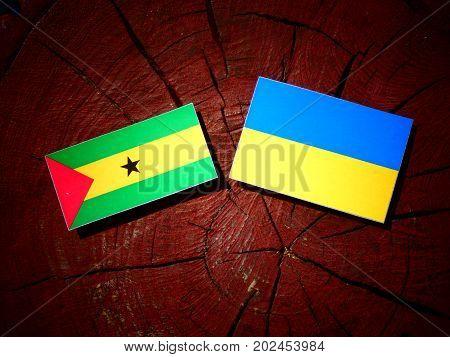 Sao Tome And Principe Flag With Ukrainian Flag On A Tree Stump Isolated