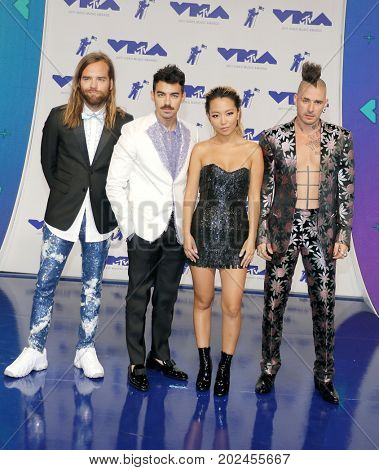 Jack Lawless, Joe Jonas, JinJoo Lee and Cole Whittle of DNCE at the 2017 MTV Video Music Awards held at the Forum in Inglewood, USA on August 27, 2017.