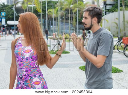 Love couple with relationship difficulties outdoor in the city in the summer