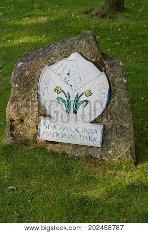 Betws y Coed Wales UK - August 15 2017: Boundary sign for Snowdonia National Park or Parc Cenedlaethol Eryri in Welsh . The park was set up in 1951 covers 823 square miles and includes Wales's highest peak Mount Snowdon or Yr Wyddfa