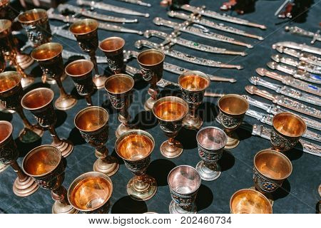 Cups decorated with jewels. Flea market Vernissage Yerevan, Armenia