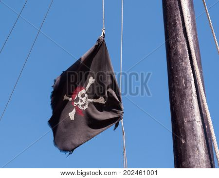 Pirate flag that flies on the mast of the ship. Tunisia June 2017