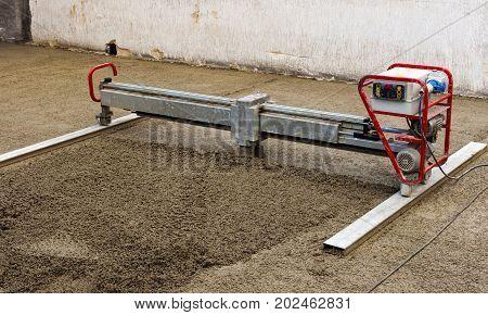 Construction site - machine running screed flooring
