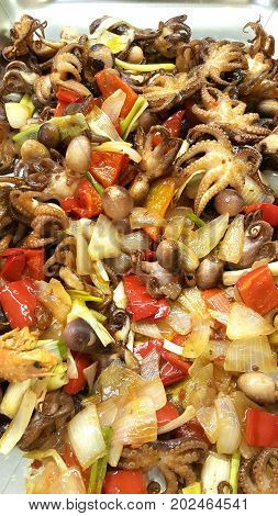 a dish with octopus appetizer and mushrooms