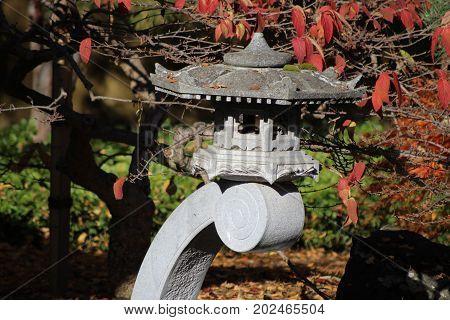 Japanese Lantern In A Zen Garden In The Autumn