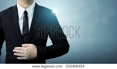 Young executive businessman in suit with copy space Employee success in company concept