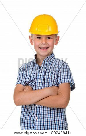 Handsome boy in blue checkered shirt and yellow building helmet, smiling on white background.
