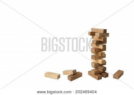 Structure building of wooden blocks into tower on isolated white background with clipping path to show business building or start up concept idea that takes risk and to be success from past learning experience
