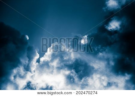 Magnificent storm clouds in the evening sky. High contrast dramatic scenery. Monochrome photograph.