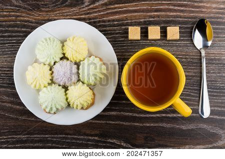 Cup Of Tea, Plate Of Cookies With Souffle, Teaspoon