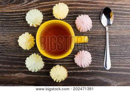 Cookies With Souffle Around Cup Of Tea And Teaspoon