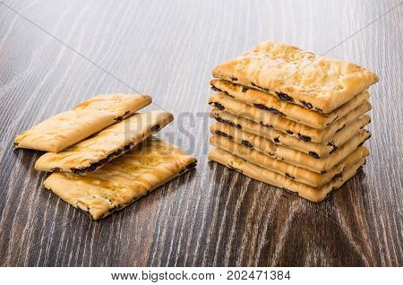 Stack Of Cookies With Raisin On Wooden Table
