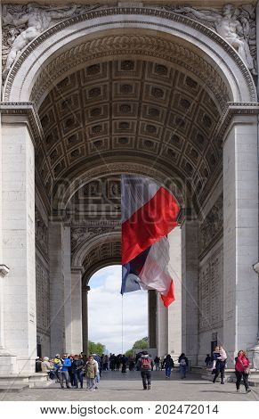 Paris; France- May 01; 2017: Triumphal arch on the Champs Elysees. Tourists inspect it and take pictures