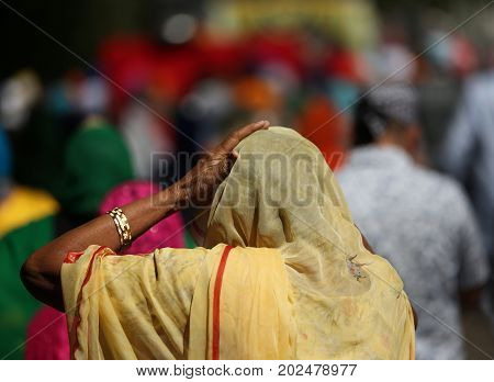 Elderly Woman With Headscarf During A Religious Ceremony Outdoor