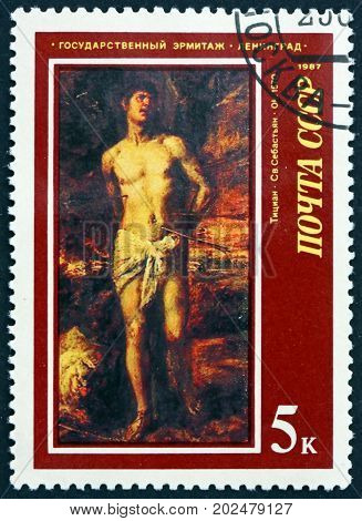 RUSSIA - CIRCA 1987: a stamp printed in the Russia shows St. Sebastian Painting by Titian Italian Painter circa 1987
