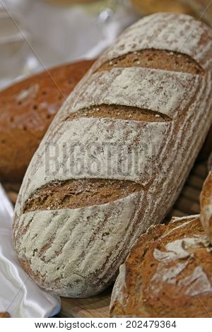 Pieces Of Fresh Bread In The Bakery With Fragrant Loaves And Bag